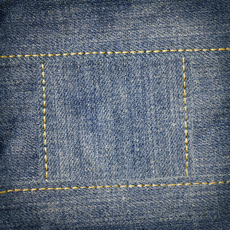 seams: Jeans texture with yellow seams frame background