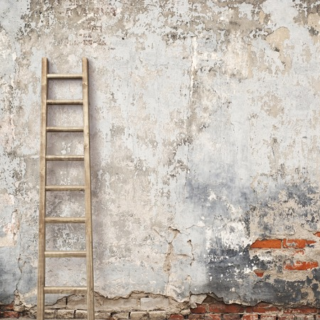 ancient brick wall: weathered stucco wall with wooden ladder background