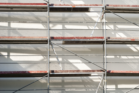 gripping bars: restoration facade of a house, scaffolding construction