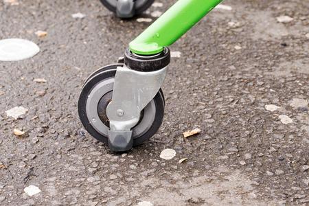 Wheel of shopping cart on wet ground