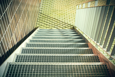 emergency stair: Metal stairs with railings, brick wall background Stock Photo