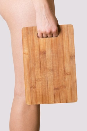 young girl holding old wooden chopping board Banque d'images
