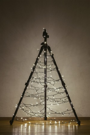 festoon: Christmas tree made of camera tripod, decorated by the lights