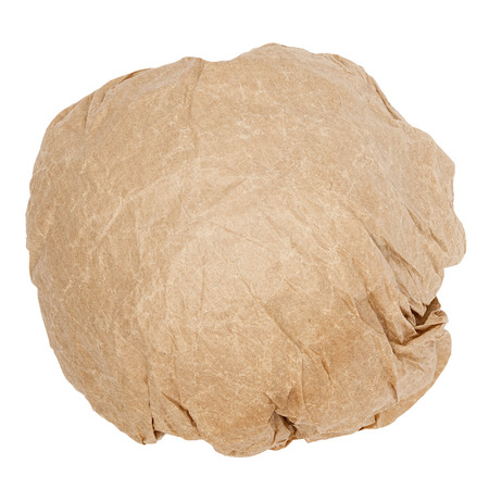 wastrel: crumpled brown paper ball isolated on white background Stock Photo