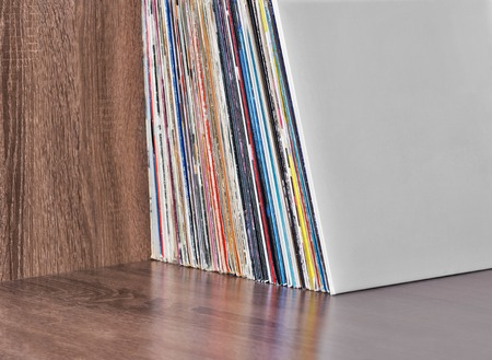 vinyl records: Old Vinyl records in the wooden shelf