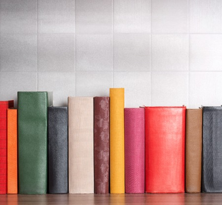 stack of books on the shelf, blank spines