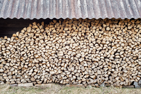 woodshed: stack of chopped firewood in the woodshed