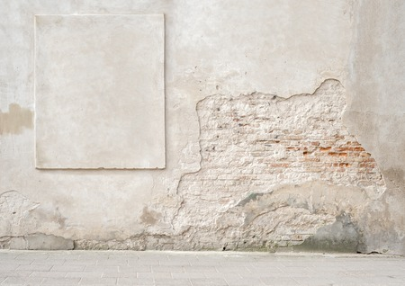 grudge: abandoned grunge cracked brick stucco wall with a stucco frame Stock Photo