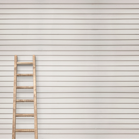 backstairs: white wooden plank wall with ladder background