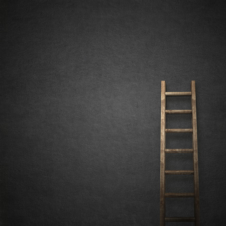 crack climb: black stucco wall, ladder near the wall background Stock Photo
