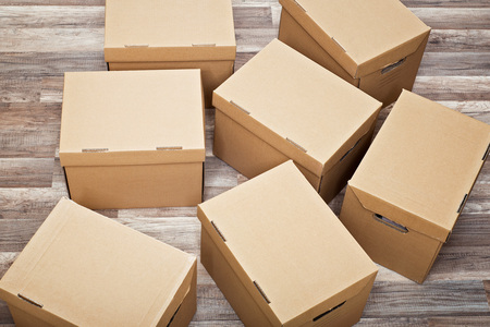 Many moving boxes on the wooden floor
