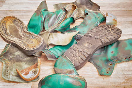 steel toe boots: High black and green leather boots templates Stock Photo