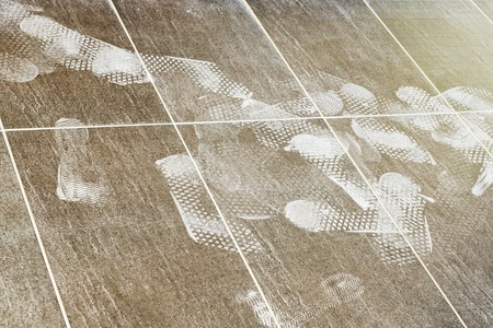Foot prints on the tiled floor, construction site