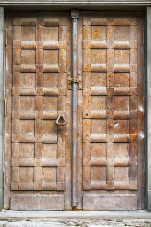 corrosion: brown grunge rusty metal door of church Stock Photo