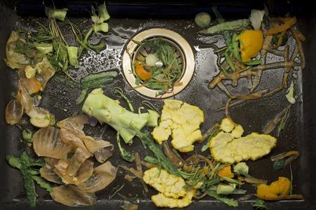 sink drain: fresh vegetable scarp in the black sink