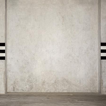 weathered: Empty parking garage underground, grunge stucco wall
