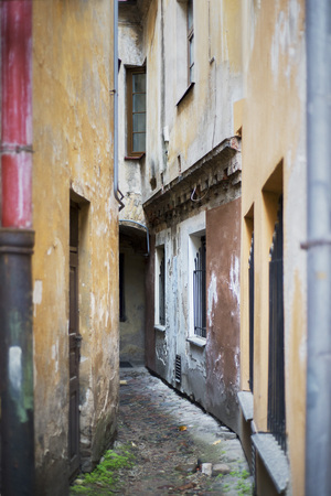 very narrow and dirty alley in the old town. The narrowest street in Vilnius, Lithuania