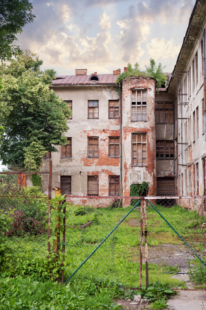 Abandoned jewish hospital with boarded up window in Kaunas, Lithuania built in 1836 Stock Photo