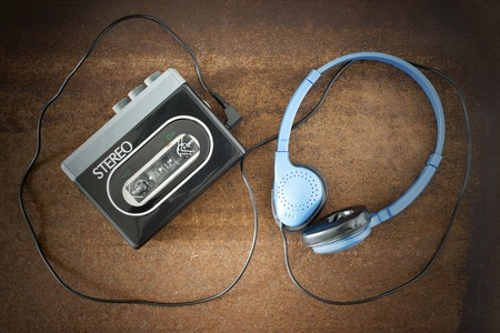 Vintage walkman and headphones on the wooden background Stock fotó