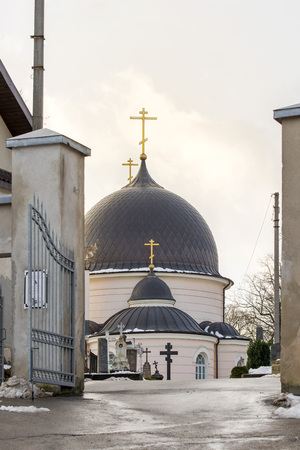 Russian orthodox church at the cemetery in winter Stock Photo