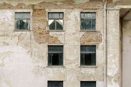 abandoned grunge cracked stucco wall with with window Stock Photo