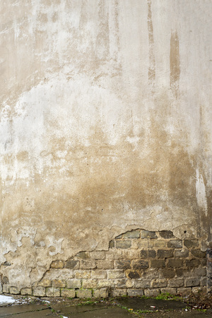 Abandoned cracked stucco brick wall texture background
