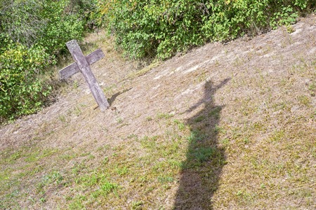 Shadow of the cross on the ground. Abandoned graveyard in summer 版權商用圖片
