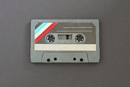 Retro black with colorful stripes in the left corner audio tape on black paper background Banco de Imagens