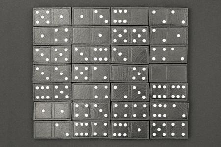 Black domino isolated on black paper bacground. Full set. Banco de Imagens