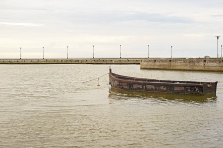 Wooden boat in the sea. Early morning near the sea pier.