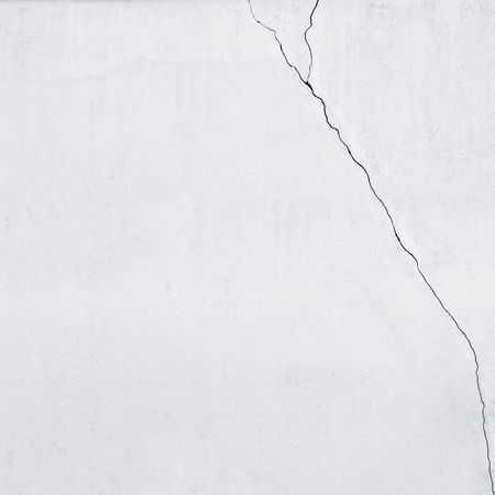 Part of stucco cracked dirty white wall background