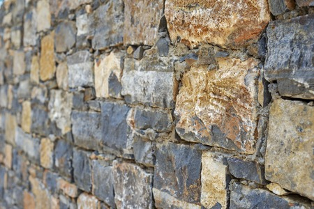 Part of grunge colorful stone wall. Perspective view. Banco de Imagens