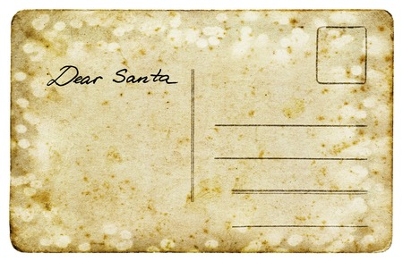Old vintage postcard with a title Dear Santa isolated on white background. Christmas letter to Santa Claus Banco de Imagens