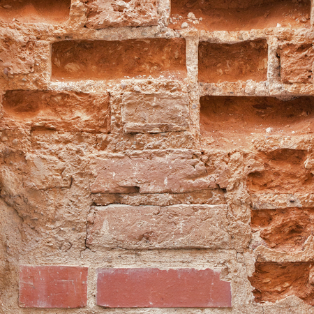 close-up abandoned grunge cracked brick stucco wall background