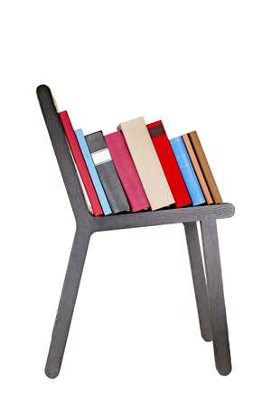 Colorful books on wooden chair isolated on white background.