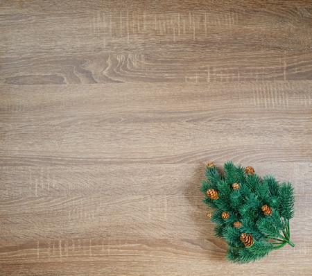 Christmas tree on brown wooden texture background