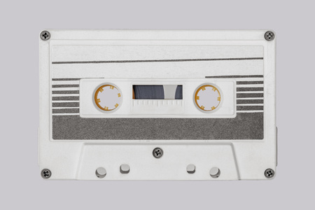 Retro white audio cassette tape isolated on white background. Black striped label. Banco de Imagens - 123353516
