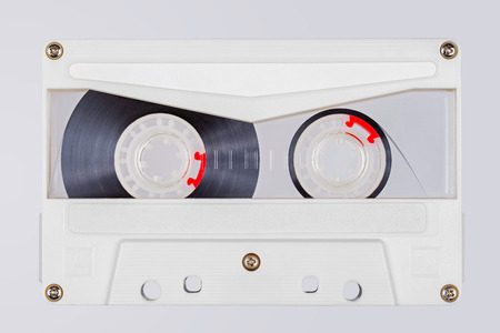 Retro white transparent audio tape isolated on white background