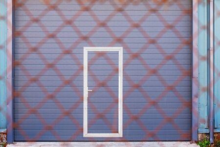 Dark grey doors of industrial warehouse for vehicles