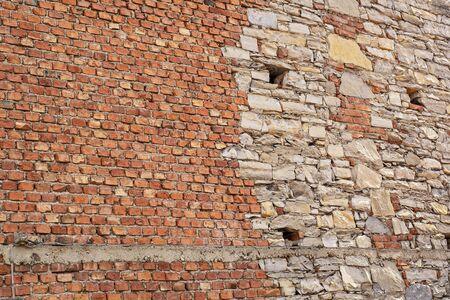 cracked red brick grunge wall of old house background Standard-Bild