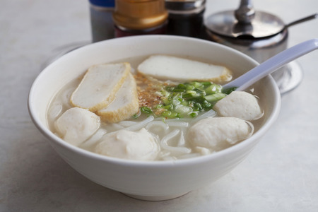 Rice noodle soup with fish balls photo