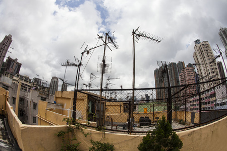tenement buildings: Old Tenement Buildings a Roof have many Old Style Yagi-Uda antenna, Hong Kong Stock Photo