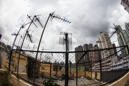 tenement: Old Tenement Buildings a Roof have many Old Style Yagi-Uda antenna, Hong Kong Stock Photo