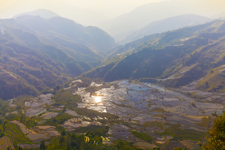 terraced: Sunset of terraced rice fields in Laohuzui, Yuanyang County