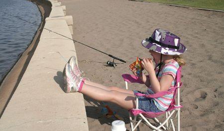 Little girl fishing Stock Photo - 1350852