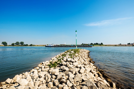 spur: Ship passing by Spur Dyke at Krefeld  Germany Stock Photo