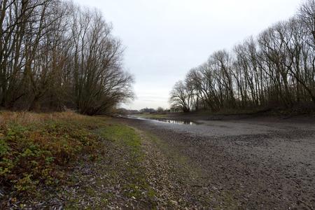rhine westphalia: Poor Rain so far at Arm of River Rhine Germany Stock Photo
