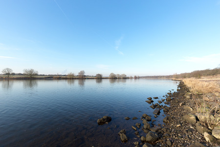 maas: Mighty River Maas with tranquil mood at Winter Day Netherlands