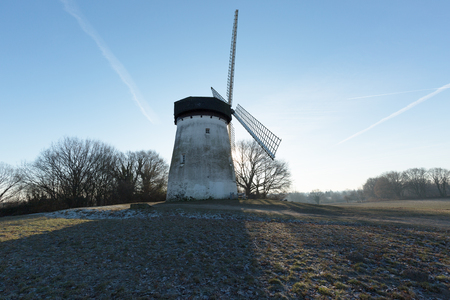 winterday: Traar Windmill at Sunrise on a Winterday Germany Stock Photo