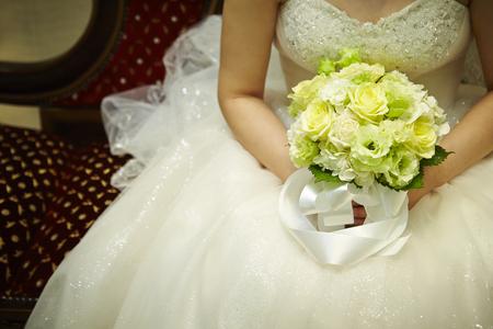 vows: Bride holding wedding bouquet